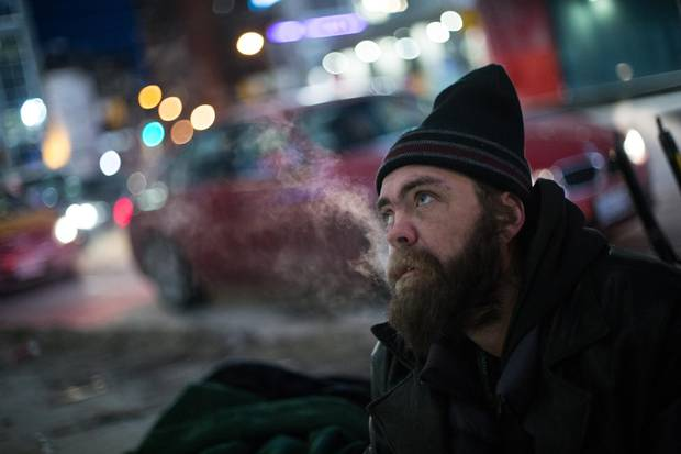 Eyrish, who has experienced homelessness off and on over the past few years, panhandles in Toronto on Jan. 12, 2018. While he is precariously housed right now, he said he'd rather sleep on the street than go to a shelter or a drop-in.