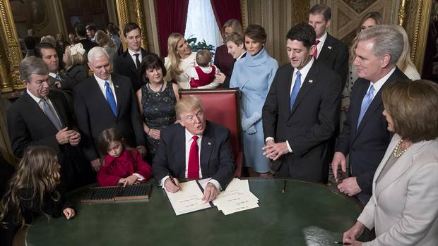 President Donald Trump is joined by the Congressional leadership and his family as he formally signs his cabinet nominations into law, in the President's Room of the Senate, at the Capitol in Washington.