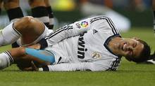 Real Madrid's Cristiano Ronaldo grimaces after being fouled during their Spanish first division soccer match against Granada at the Santiago Bernabeu stadium in Madrid September 2, 2012. (PAUL HANNA/REUTERS)