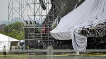Ministry of Labour inspectors (left), pour over the collapsed stage at Downsview park that killed one man when it partially fell down prior to a Radiohead concert, June 17, 2012. (J.P. Moczulski for The Globe and Mail) (J.P. MOCZULSKI)