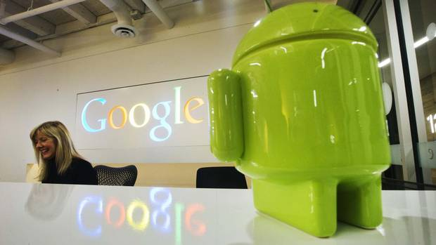 An Android figurine sits on the welcome desk at Google Canada's new office in downtown Toronto. (MARK BLINCH/REUTERS)