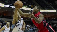Memphis Grizzlies guard Jerryd Bayless (7) fights for a rebound against Toronto Raptors guard Kyle Lowry (3) in the first half of an NBA basketball preseason game on Friday, Oct. 26, 2012, in Memphis, Tenn. (Associated Press)
