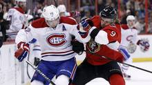 Montreal Canadiens' Erik Cole (L) collides with Ottawa Senators' Milan Michalek during the first period of their NHL hockey game in Ottawa March 16, 2012. (BLAIR GABLE/REUTERS)