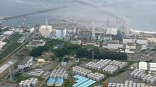 An aerial view shows Tokyo Electric Power Co. (TEPCO)'s tsunami-crippled Fukushima nuclear power plant and its contaminated water storage tanks (bottom) in Fukushima, in this file photo taken by Kyodo August 20, 2013. (KYODO/REUTERS)