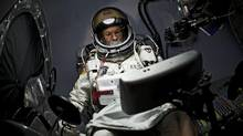 Austrian extreme sportsman Felix Baumgartner goes through dress rehearsal at Red Bull Stratos mission headquarters in Roswell, New Mexico, in this October 6, 2012, handout photo. Mr. Baumgartner's record-breaking jump from 120,000 feet, scheduled for Tuesday, will be closely tracked by HD cameras in his capsule, on his body, in the air and on the ground, as the Austrian's plunge through the sound barrier promises to be the best-documented high-altitude jump ever and can be watched in real time not only by the Mission Team but also by viewers around the world. (Reuters)
