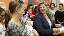 Ontario NDP leader Andrea Horwath stands with new mothers and their babies at a birthing centre in Toronto during her election campaign on Wednesday September 21, 2011. (THE CANADIAN PRESS / Chris Young/THE CANADIAN PRESS / Chris Young)