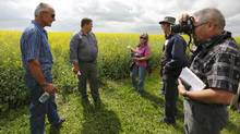 A group from Quebec talks to farmer Peter Sprunger about water issues while touring oil and gas operations near Rosemary, Alta. (Todd Korol for The Globe and Mail)