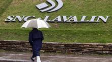 A pedestrian walks past the SNC-Lavalin Group Inc., headquarters in Montreal, in this file photo. (Christinne Muschi/Reuters)