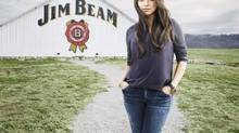 A promotional images released by Jim Beam bourbon showing its new celebrity spokeswoman Mila Kunis.