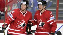 Canada's Jamie Benn and Corey Perry, right, celebrate Benn's opening 1-0 goal of a match between Canada and Slovakia during the 2012 IIHF Ice Hockey World Championships in Helsinki, Finland on Friday (Martti Kainulainen/Associated Press)