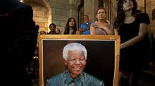 People attend a special Sunday morning service dedicated to Nelson Mandela at St. George's Cathedral in Cape Town December 8, 2013. South African anti-apartheid hero Mandela died aged 95 at his Johannesburg home on December 5, 2013 after a prolonged lung infection. (STRINGER/REUTERS)