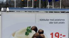 A billboard in the parking lot at the IKEA store in Stockholm advertises meatballs in a Feb. 25, 2013 file photo. (SCANPIX SWEDEN/REUTERS)