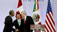 U.S. President Barack Obama, Mexico's President Enrique Pena Nieto and Canadian Prime Minister Stephen Harper, shake hands at the end of a news conference concluding the North American Leaders Summit in Toluca, Mexico, on Feb. 19, 2014. (EDUARDO VERDUGO/ASSOCIATED PRESS)
