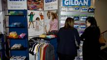 Shareholders look at Gildan products in this file photo. (Christinne Muschi for The Globe and Mail)