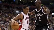 Toronto Raptors guard DeMar DeTozan getrs hung up as he tries to drive around Brooklyn Nets forward Kevin Garnett during first half NBA action in Toronto on Tuesday November 26, 2013. (The Canadian Press)
