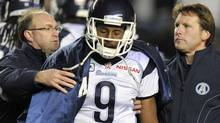 Toronto Argonauts quarterback Steven Jyles leaves the game with an injury after being hit by the Winnipeg Blue Bombers during the second half of their CFL game in Winnipeg, October 28, 2011. REUTERS/Fred Greenslade (Fred Greenslade/Reuters)