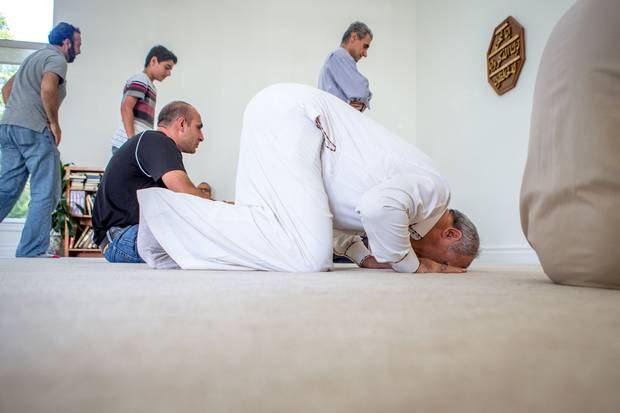 Mr. Sharbaji prays at the mosque during Friday prayers.