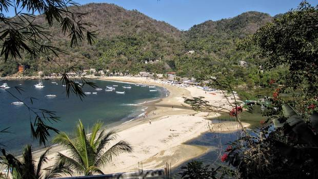 The beach at Yelapa lets you hike into the mountains to a waterfall or go horseback riding.