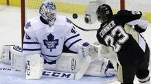 Pttsburgh Penguins' Chris Conner (23) lifts the puck over Toronto Maple Leafs goalie Jonathan Bernier for a first-period goal during an NHL hockey game in Pittsburgh, Wednesday, Nov. 27, 2013. (Associated Press)