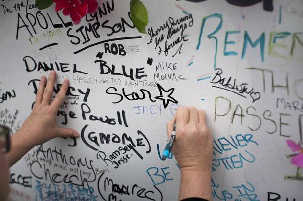 Donna May signs a memorial for overdose victims in the area known as