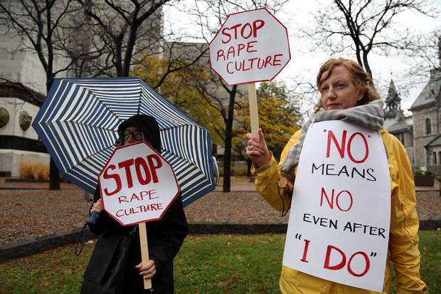 Alice Dean, left, and Ruth Greer demonstrate against rape culture in front of an Ontario courthouse.