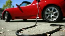 A Tesla Roadster is electrically charged at Tesla Motors Inc. in San Carlos, Calif., July 22, 2009. Until breakthroughs are made on costs and batteries, and charging networks become extensive, electric cars will remain ultra-fringe products. (ROBERT GALBRAITH/REUTERS)