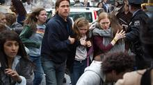 From left, Brad Pitt as Gerry Lane, Abigail Hargrove as Rachel Lane, and Mireille Enos as Karin Lane in a scene from World War Z. (Jaap Buitendijk/Paramount Pictures/AP)