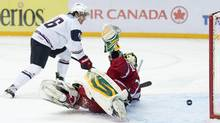 Team USA forward Riley Barber, left, scores past Czech Republic goalie Matej Machovsky, right, during second period quarter-final IIHF World Junior Championships hockey action in Ufa, Russia on Wednesday, Jan. 2, 2013. (The Canadian Press)
