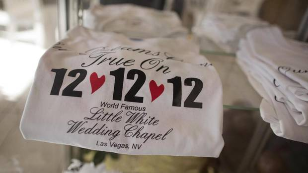 Tee shirts advertising the 12-12-12 date sit on display at A Little White Wedding Chapel, Tuesday, Dec. 11, 2012, in Las Vegas. These once-in-a-century wedding dates have become more important each year as people increasingly look outside Vegas for nontraditional weddings. (Julie Jacobson/AP)