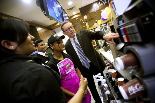 McDonald's Canada CEO John Betts, right, at a Toronto location in 2014.
