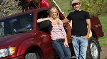 Shaun Majumder and his fiancee Shelby Fenner and his Toyota Tacoma. (Ann Johansson For The Globe and Mail)