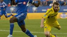 Montreal Impact's Patrice Bernier and Columbus Crew's Eddie Gaven battle for the ball during first half MLS action in Montreal, Sunday, July 8, 2012. (Paul Chiasson/THE CANADIAN PRESS)
