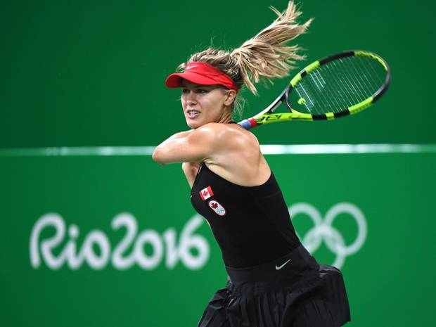 Canada's Eugenie Bouchard follows through after returning to Sloane Stephens of the United States in first round women's singles tennis at the 2016 Olympic Games on August 6, 2016.