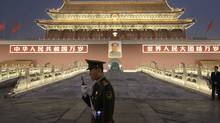 Chinese paramilitary police officer stands guard in front of Tiananmen gate in Beijing, China, Tuesday. (Vincent Thian)