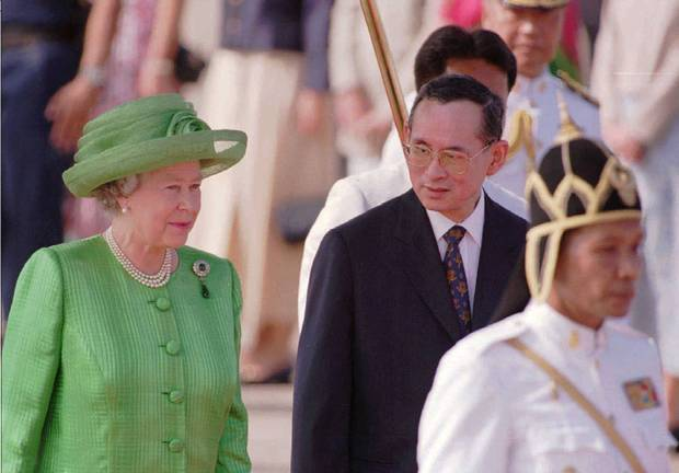 Thailand's King Bhumibol Adulyadej chats with the Queen in Bangkok on Oct. 28, 1996.