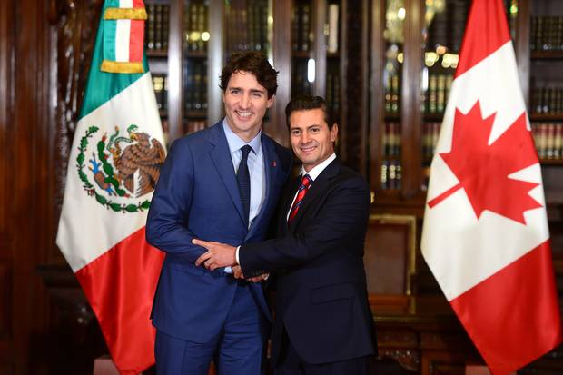 Canadian Prime Minister Justin Trudeau, left, and Mexican President Enrique Pena Nieto shakes hands during a meeting at the Palacio Nacional in Mexico City on Oct. 12, 2017.