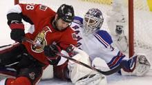 The Ottawa Senators' Zenon Konopka drives to the net on New York Rangers goalie Henrik Lundqvist in the first period. (Blair Gable/Reuters/Blair Gable/Reuters)