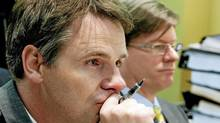 Lawyer Paul Champ, left, and Alain Prefontaine of the Department of Justice listen as the Military Police Complaints Commission resumes hearings related to a complaint about military police conduct in Afghanistan on Tuesday in Ottawa. (Sean Kilpatrick/The Canadian Press)