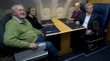 Canadian Prime Minister Stephen Harper speas with former prime ministers Brian Mulroney(left), Kim Campbell and Jean Chretien on board a government plane travelling to South Africa Sunday December 8, 2013. (Adrian Wyld/THE CANADIAN PRESS)