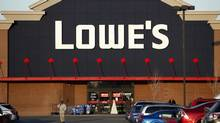 A customer walks out in front of a Lowe's store in Allen Park, Monday, Dec. 12, 2011. Lowe's is planning to stick by its decision to yank its ads from a reality TV show about American Muslims despite the growing opposition the home improvement chain is facing over the move. (Paul Sancya / AP)