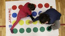 Children play the game Twister. (Lyle Stafford For The Globe and Mail/Lyle Stafford For The Globe and Mail)