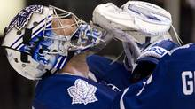 Toronto Maple Leafs goaltender James Reimer reacts at the final buzzer as his team beats Calgary Flames 3-2 in NHL hockey action in Toronto on Saturday October 15, 2011. (Chris Young/THE CANADIAN PRESS)