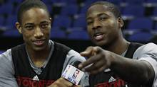 The Toronto Raptor's DeMar DeRozan and Ed Davis (R) interview each other before a basketball practice session ahead of their NBA game against the New Jersey Nets at the O2 Stadium in London March 3, 2011. (LUKE MACGREGOR)