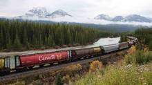 Rail cars loaded with canadian wheat travel through the Rocky Mountains on the Canadian Pacific railway line near Banff, Alberta, October 6, 2011. (TODD KOROL/REUTERS)