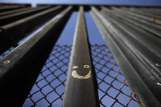 Graffitti adorns metal bars marking the United States border where it meets the Pacific Ocean Wednesday, March 2, 2016, in Tijuana, Mexico. Trump has angered many Mexicans for his campaign rhetoric denigrating some immigrants as