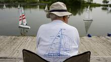 Members of the Metro Marine Modellers set sail at Humber Bay park. (Peter Power/The Globe and Mail)
