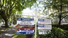 Real estate signs in the Fairview Slopes neighbourhood in Vancouver. (Rafal Gerszak For The Globe and Mail)