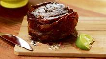Prosciutto-wrapped filet mignon with smoky molasses glaze (Photo: Jim Norton; Styling: Heather Shaw/Judy Inc.)