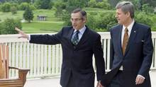 Prime Minister Stephen Harper tours the future grounds of the G8 summit in Huntsville with local Tory MP Tony Clement on June 19, 2008. (Adrian Wyld/The Canadian Press/Adrian Wyld/The Canadian Press)