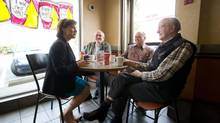 B.C. Premier Christy Clark talks with patrons at a Tim Horton's before a rally at Surrey-Fleetwood candidate Peter Fassbender's campaign office on March 26, 2013. (DARRYL DYCK FOR THE GLOBE AND MAIL)